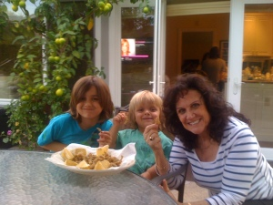 12. Grandma Lucy with Dante and Luca enjoying fried smelts.