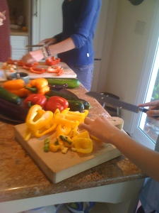 Grandkids cutting vegetables.